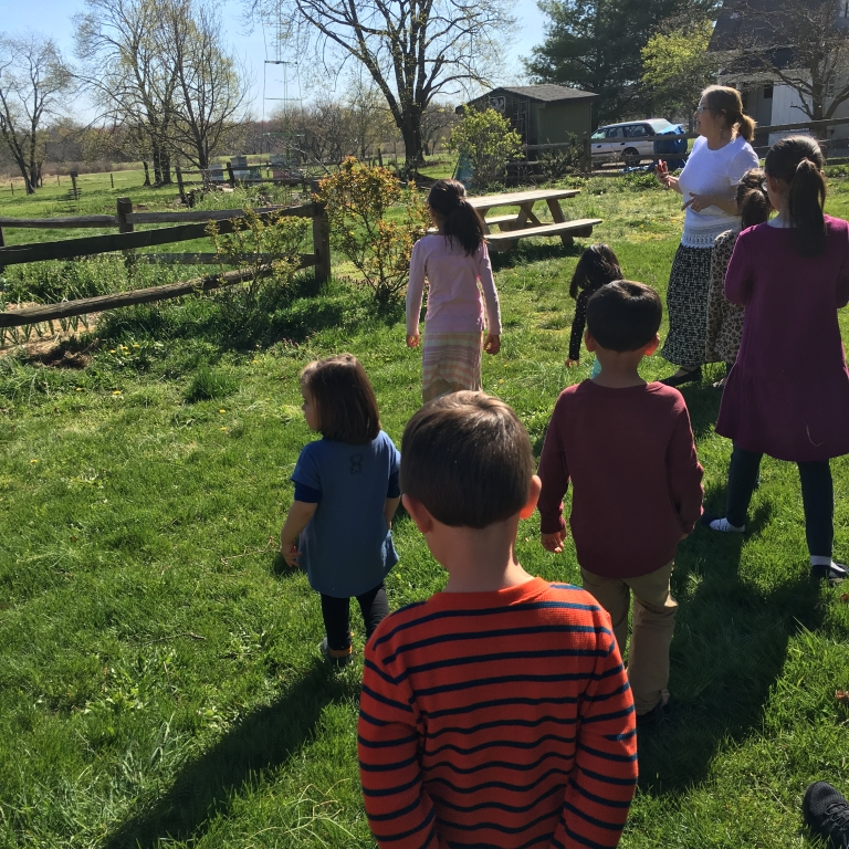 Children and guide on a farm tour