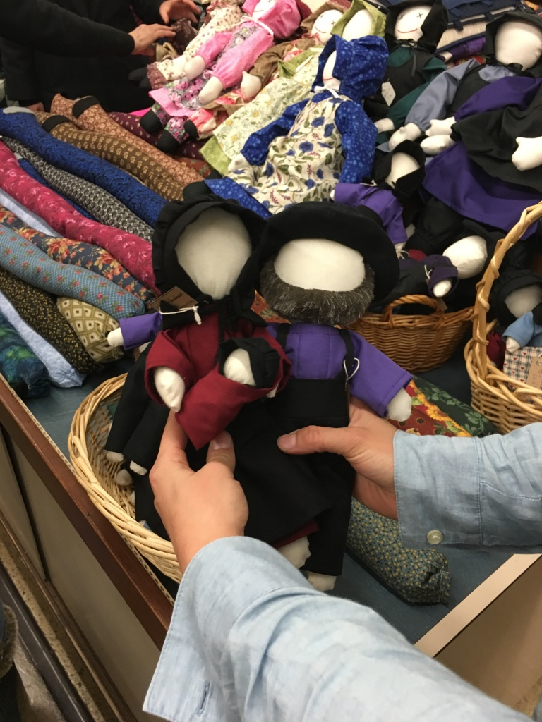 Dolls wearing plain cloths in Amish style at a market in Pennsylvania
